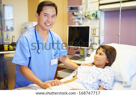 Young Girl Talking To Male Nurse In Hospital Room - stock photo