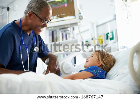 Young Girl Talking To Male Nurse In Intensive Care Unit - stock photo