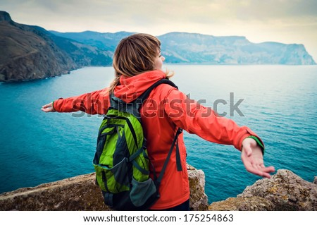 young girl tourist enjoys lovely sea views - stock photo