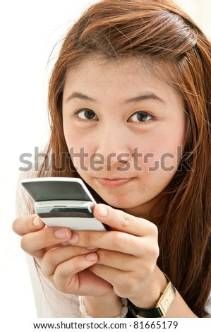 young girl using mobile phone for Chat with friends on world network - stock photo