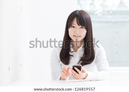 young girl using smart phone - stock photo