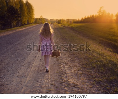 young girl walking away - stock photo