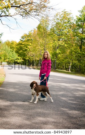 young girl walking her dog - stock photo