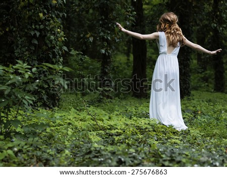 Young girl walking in the park - stock photo
