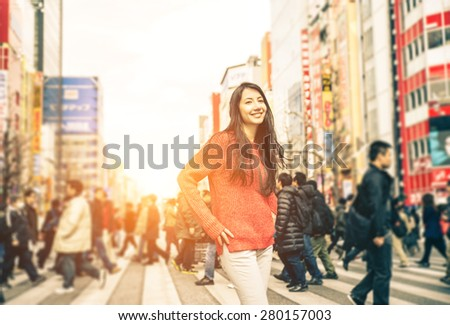 young girl walking on the streets of tokyo. concept about travel, landmarks and people - stock photo