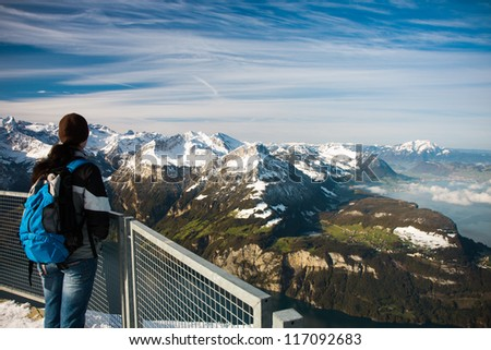 Young girl watching from the Frontalpstock peak to the Lake Lucerne - Vierwaldstattersee, Central Switzerland - stock photo