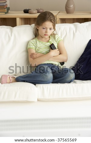 Young Girl Watching Television at Home - stock photo