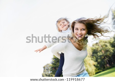 Young girl with a baby in the park - stock photo