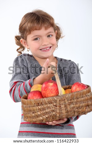 Young girl with a basket of apples - stock photo