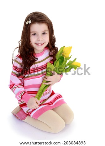 young girl with a bouquet of flowersfloral bouquet, flowers delight,happiness concept,happy childhood,carefree childhood,active lifestyle - stock photo