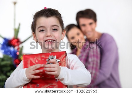 Young girl with a Christmas present - stock photo