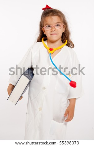 Young girl with a doctors uniform and toy instruments - stock photo