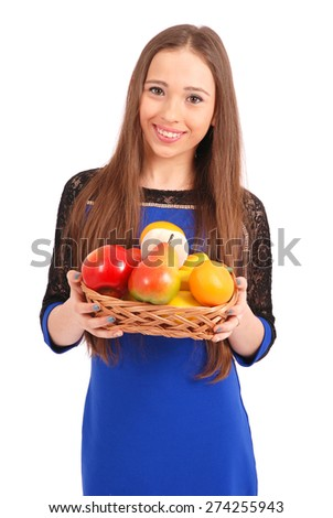 Young girl with a fruit basket isolated on white - stock photo