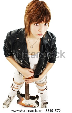 Young girl with a guitar on a white background - stock photo