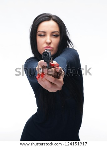 Young girl with a pistol on white background - stock photo
