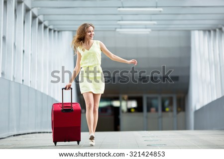 Young girl with a suitcase  - stock photo
