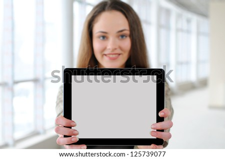 young girl with a tablet in office. focus tablet - stock photo
