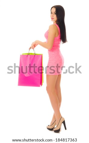 Young girl with bags isolated on white - stock photo