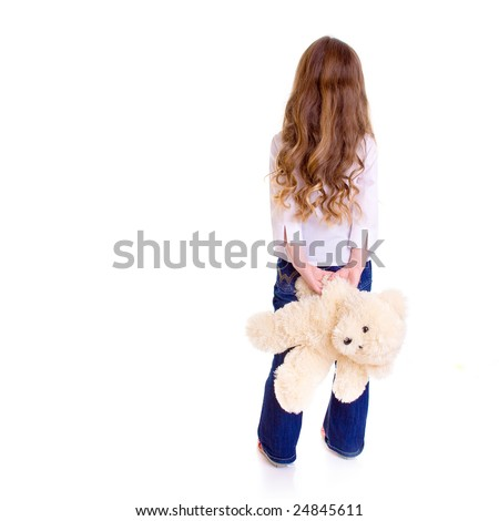 Young girl with bear on white background - stock photo