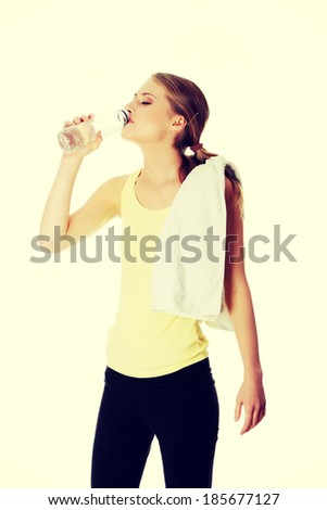 Young girl with bottle of mineral water - stock photo