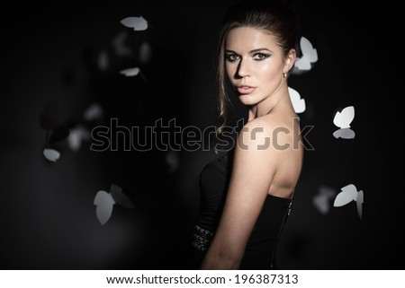 Young girl with butterflies in studio - stock photo