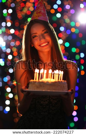 Young girl with cake in club - stock photo