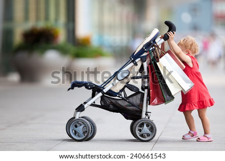 Young girl with carriage shopping series - stock photo