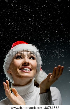 young girl with christmas present in hands - stock photo