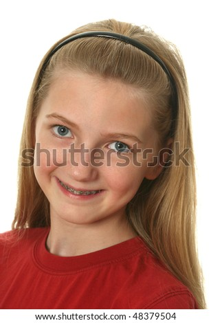 Young girl with dental braces on her teeth isolated on white - stock photo