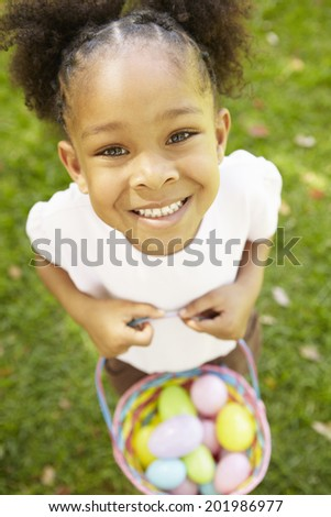 Young  girl with Easter eggs - stock photo