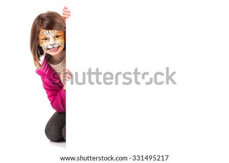 Young girl with face-paint and a white board - stock photo