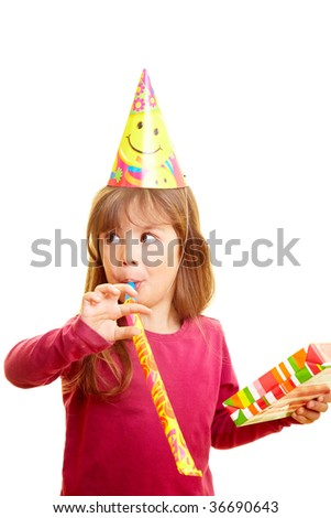 Young girl with gift, party hat and party blower - stock photo