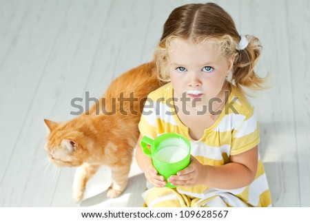 Young girl with glass of milk - stock photo