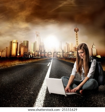 young girl with laptop on a street - stock photo