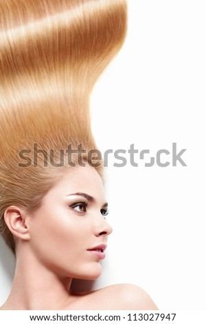 Young girl with long hair on a white background - stock photo