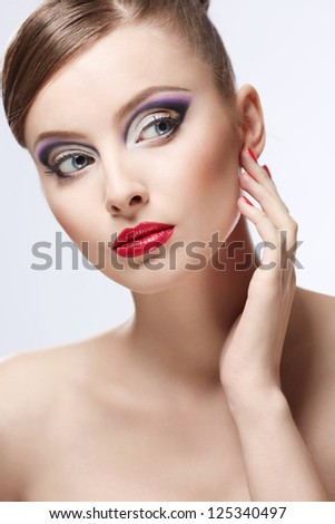 Young girl with makeup on white background - stock photo