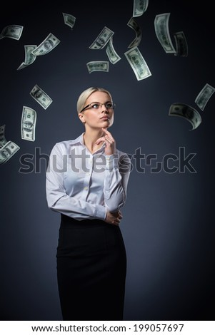 Young girl with money - stock photo