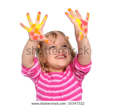 Young girl with paint on hands isolated over white background - stock photo