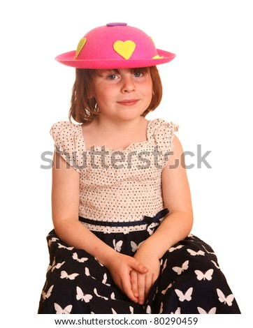 Young girl with pink hat, against white background - stock photo