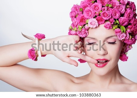 Young girl with pink rose flower in hair - stock photo
