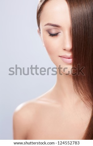Young girl with shiny hair - stock photo