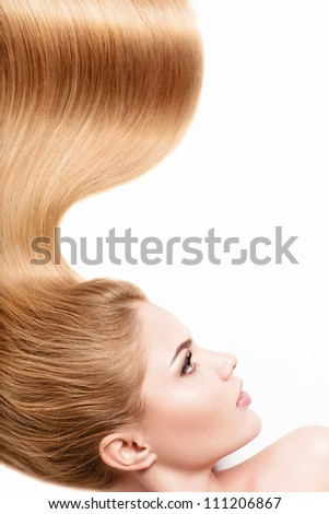 Young girl with shiny hair isolated - stock photo