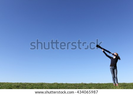 Young girl with telescope watching the sky - stock photo