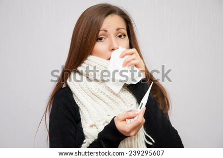 young girl with thermometer and scarf  - stock photo