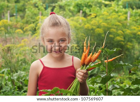 young girl working in vegetable garden - stock photo