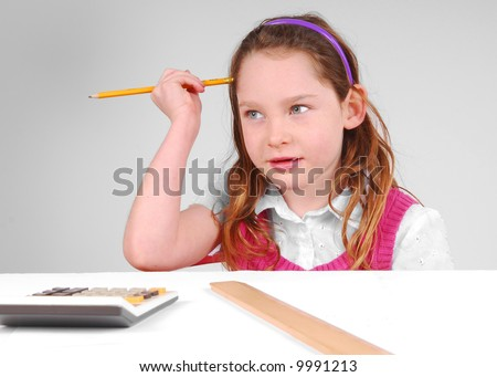 Young Girl Working on Math, Thinking Hard - stock photo