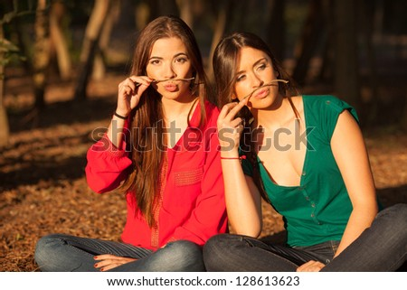 young girlfriends playing and having fun on a park - stock photo