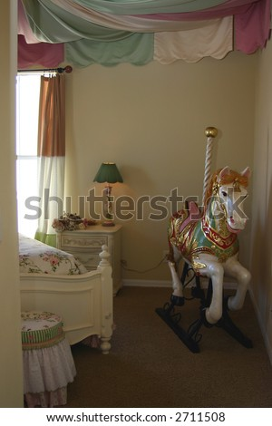 young girls bedroom interior decorated with carousel horse - stock photo