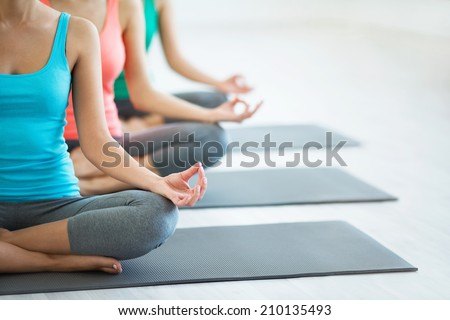 Young girls do yoga indoors - stock photo