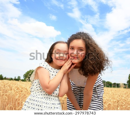 Young girls have fun in the wheat field - stock photo